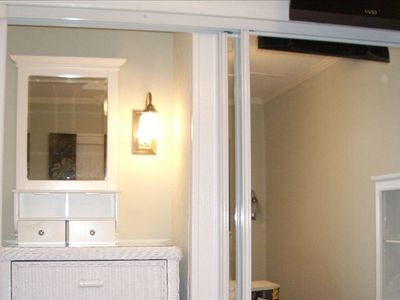 Hilton Head Island~Closet with 72 inch mirror doors & recessed lighted dresser.
