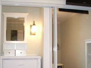 Hilton Head Island~Closet with 72 inch mirror doors & recessed lighted dresser. - Folly Field condo vacation rental photo