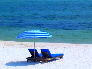 Perdido Key condo photo - Umbrella + 2 Chairs set up on the beach each day for you!