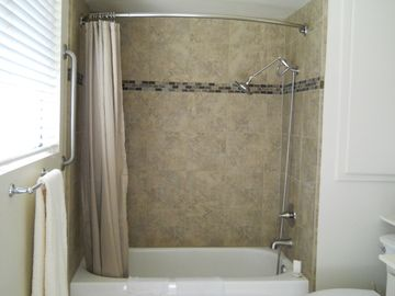 Master bath all-over tiled shower-tub