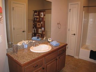Branson condo photo - 2 bathrooms have granite vanity, tile floors and tub/shower combo.