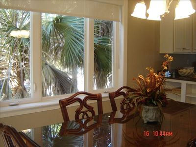 Another view of the dining table with palms just out the window.