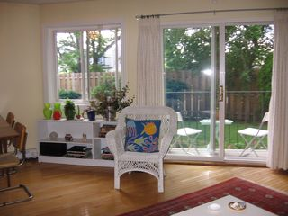 Boston condo photo - Living/dining room, with deck, back yard, and skyline view in left window