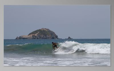 Surfing on Playitas beach
