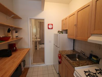 East Village apartment rental - Another view of the kitchen with direct access to the bathroom