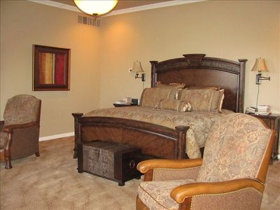 Inviting pillow top king bed in master faces flat screen HDTV and overlooks lake