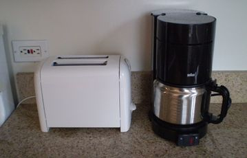 Coffee maker and toaster are provided.