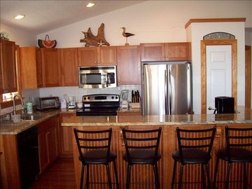 Well equipped updated kitchen with breakfast bar that seats 4 additional guests!