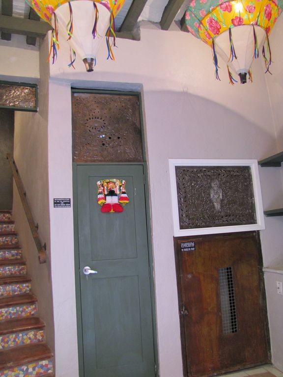 Entrance with 'dumb waiter' on the right and decorative tin