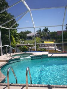 Beautiful & well maintained pool with view of the Boat Dock