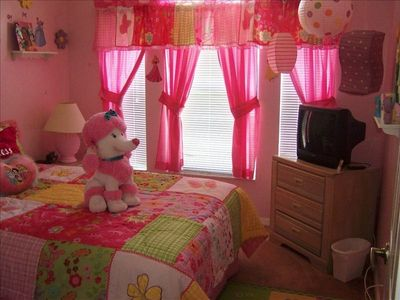 Princess Room With a Queen Bed and TV Ceiling Fan