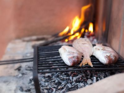 Chia apartment rental - Cooking Fish on the BBQ in your Casa!