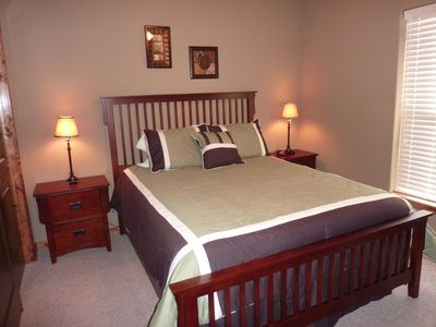 Bedroom on lower level with queen bed