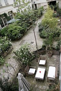 Private Courtyard for Apartment - Yes, you get your own private area to visit with friends in the courtyard just below the unit. You will be able enjoy drinks, or even smoke since all CobbleStay apartments are strictly non smoking.