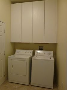Laundry room with washer/dryer and cabinet storage