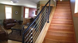 Duluth house photo - Stairway: reclaimed fir stairs and custom/handmade railing.