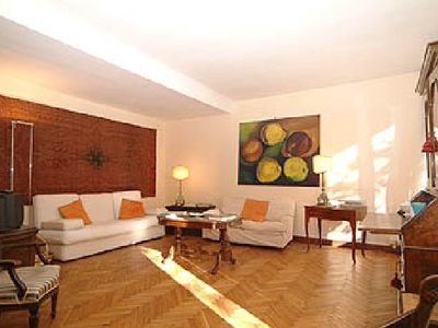 The bright living room opens to the private garden