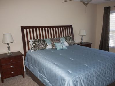 second master with king bed and bathroom with flat screen tv