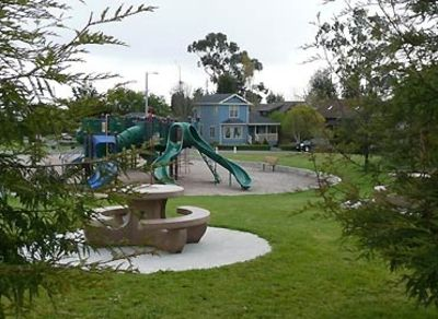 Stewart School Park, Parkside Cottage is to the right of the blue residence
