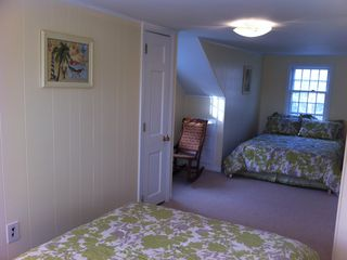 Bedroom # 3, upstairs, large, two double beds, bay windows, new mattresses, AC