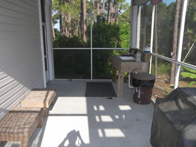 Screened porch under unit with fish cleaning station and grilling station