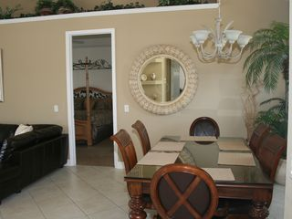 Vacation Homes in Marco Island house photo - Dining room overlooks parklike setting to front, pool and lagoon to back.