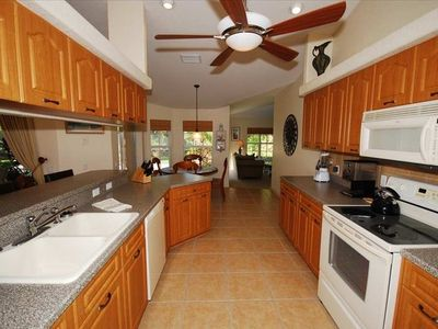 Open, fully equipped kitchen, with site lines throughout.