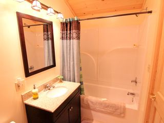 Windham cabin photo - Beautiful Full Bathroom with soaking tub and pine cathedral ceiling