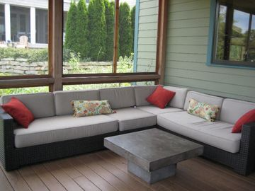 Screened in porch seating area