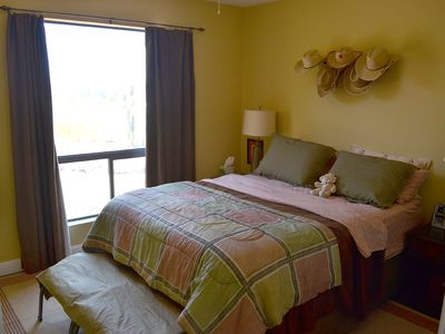 1 of 3 guest bedrooms. Queen size bed with pillow mattress