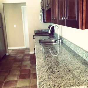 The updated kitchen, with granite countertops, new cabinets and appliances