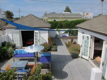 Santa Cruz cottage rental - Patio Area with Playroom ahead, and Cottage to the right, Hot Tub in far right