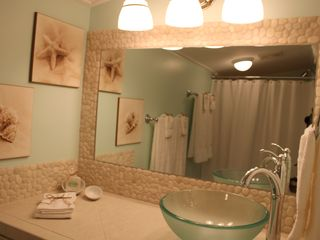 Nags Head cottage photo - Totally renovated bathroom with tile countertop and natural pebble backsplash.