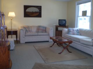 Beulah apartment photo - Living room has sleeper sofa, love seat, tv