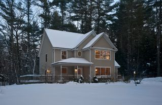 Woodstock house photo - Warm + cozy home at dusk in winter
