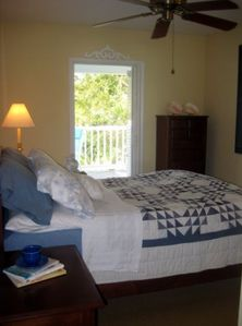 Queen Bed with balcony entrance. Furnished with Ethan Allen throughout condo.