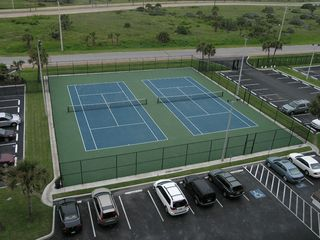 Galveston condo photo - Lighted tennis courts and private parking.