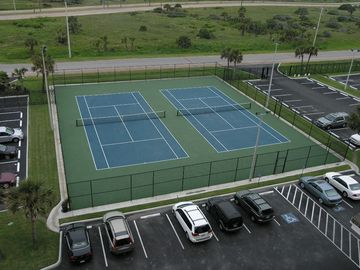 Lighted tennis courts and private parking.