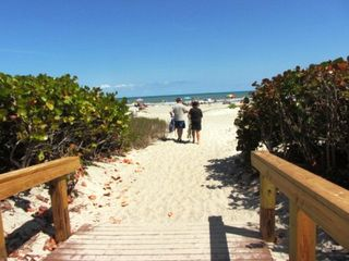 Private gated walkway to the beach just steps from the main building entrance - Cocoa Beach condo vacation rental photo