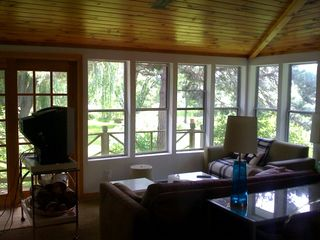 Coxsackie farmhouse photo - living room sunroom with river view