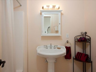 Bathroom for room with twin beds, with tub and shower