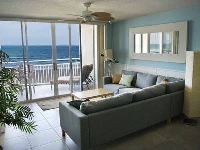 Open concept living room with beach and ocean view.