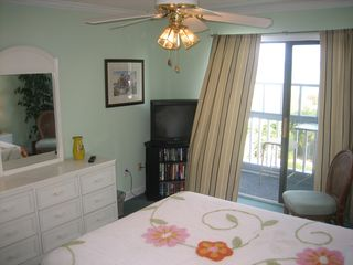 Surfside Beach condo photo - Television, in suite bath and balcony access create your own private retreat