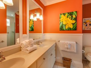 Key West house photo - The en-suite bathroom has twin vanities and a large custom shower.