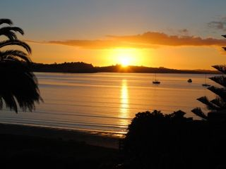 North Shore villa photo - Watch sunsets over Auckland's premier beachfront