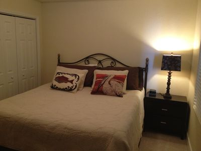 King size master bedroom with room darkening curtains added