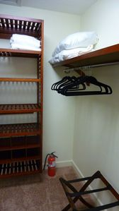 Master closet has hanging on two sides & shelving for your personal items.
