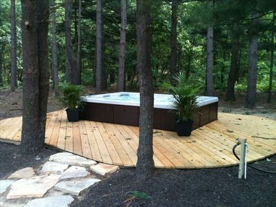 9-person hot tub under the pine trees