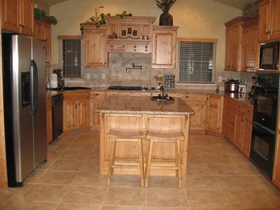 Main Floor - Kitchen with double ovens, 2 sinks, many cabinets and counter space