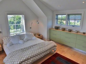 Sunny Master Bedroom Sleeping Area Features Vaulted Ceiling & Built-ins